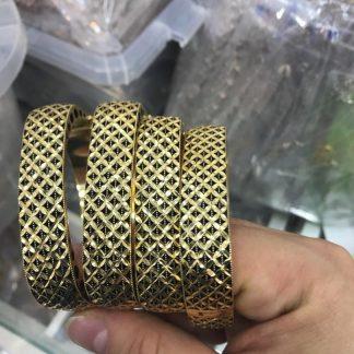 دستبند پهن سیاه قلم طرح طلا
